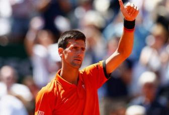 <b style='background-color:Yellow'>Nole</b> dung Stan tai chung ket Roland Garros 2015