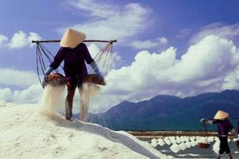 Salt farmers suffer losses as stock piles up
