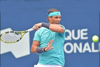 <b style='background-color:Yellow'>Nadal</b> thang chat vat tran ra quan Rogers Cup